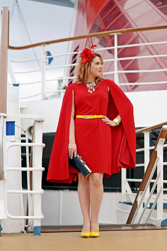 Canadian Winnipeg Style Fashion Blog, Adrianna Papell red structured cape sheath dress, Danier leather yellow belt, Precis petite red feather flower fascinator, Betsey Johnson bow crystal collar choker necklace, Kate Spade all aboard cruise boat ship navy patent leather clutch purse, Kate Spade Fast Lane car earrings ring, John Fluevog yellow Big Presence Desmond linen pump shoe Carnival Pride Cruise