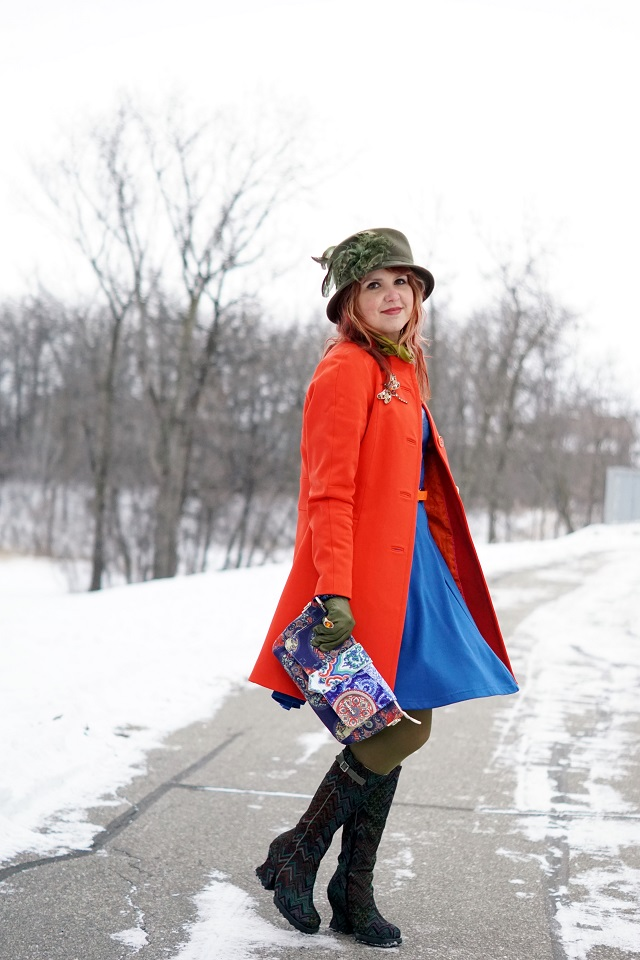 Winnipeg Canadian Fashion Stylist Consultant blog, Danier leather cobalt blue Milly fit and flare dress, Pink Tartan tangerine orange raglan car coat, Farbella loden green wool feather dress hat, Choies Pekoe blue white porcelain baguette bag, Hue loden green tights, John Fluevog Stop it Arresto zigzag knee high boots