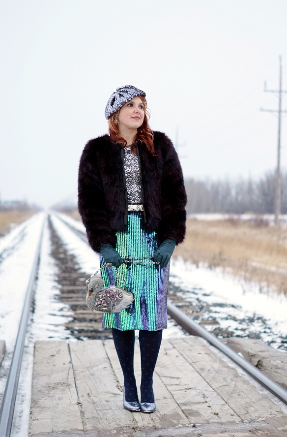 Winnipeg Canadian Fashion Stylist Blog, H&M multicolor navy purple faux fur jacket coat, H&M iridescent green purple blue pencil midi skirt, Mary Frances Swan Lake sequin beaded clutch purse, INC International Concepts silver sequin top, Danier leather blue gloves, Le chateau silver sequin beret hat, John Fluevog silver sparkle Miracle Medugorje pump shoes