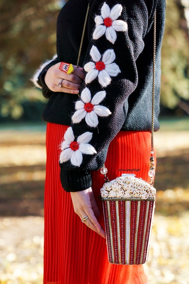 Winnipeg Style fashion blog, Canadian stylist, Chicwish hand knit daisy sleeve black sweater, Mary Frances popcorn beaded handbag, Sparkle Bomb swarovski crystal acrylic popcorn necklace and ring, Forever 21 red pleated chiffon skirt