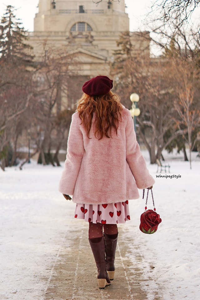 Winnipeg Style, Canadian fashion blog, vintage classic style women's fashion, Chicwish wine and pink heart print pleated skirt, Chicwish pastel pink faux fur cozy coat, Mary Frances princess disney style red rose bag purse, Sorel after hours lace up wine leather wedge knee high boots