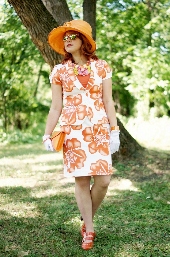 Winnipeg Fashion Blog, Canadian Fashion Blog, Canada, Baia bright orange flower print white cotton skirt blazer suit, Icing flower bold bright necklace collar, Cleo orange tank top, Deborah fashions orange calla lily hat, Danier orange croc print clutch purse, Orange avon enamel bangle, orange leather Joan Rivers watch, vintage Rhymes with Orange white gloves, Fluevog orange leather Operetta Fiorenza slingbacks