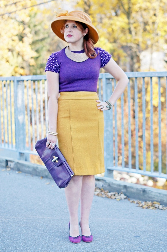 Winnipeg Fashion Blog, Canadian Fashion Blog, Pink Tartan Vienna plum purple pearl shoulder crewneck sweater, Banana Republic spicy yellow mustard soild textured pencil skirt, Farbella yellow mustard wool feather dress fall winter hat, Le Chateau bronze crystal bib collar necklace, Joan Rivers gold enamel bangles, Kenneth Jay Lane bronze coil snake wrap watch, Joan Rivers gold bronze glass pearl stud earrings, Danier Leather plum purple turnlock clutch, Fluevog purple plum Miracle Cana suede pumps heels