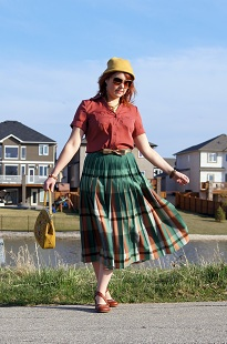 Everyday Outfit for May 3, 2012, Vintage pleated reversible coral rose green long skirt, Reitmans button front blouse, Vintage mustard wool hat, Icings floral sunglasses, Vintage mustard floral embroidered clutch top handbag, Danier bronze leather bow belt, Fluevog Operetta Viardot