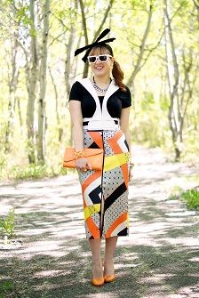 Everyday Outfit for May 3, 2013, BCBG Max Azria white Stappy Vest Harness leather, Topshop front slit orange yellow geometric silk calf skirt, Reitmans black t shirt top, Danier leather orange envelope clutch, Lia Sophia black enamel crystal necklace, Diesel enamel cuff orange green white watch, Winners neon orange stretch bracelet, BCBG Max Azria neon yellow gold ring, Adia Kibur neon yellow enamel earrings, Aldo white pixcelated cartoon video game sunglasses, Vintage black velvet bow headband, Fluevog orange patent leather Miracle Medjugorje pump heels