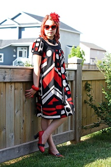 Everyday Outfit for July 19, 2012, Lori M collection geometric dress, Icing red hair flower clip, Forever 21 black leatherette flower necklace, Expression red enamel bracelet, Fluevog red black Vanny shoe