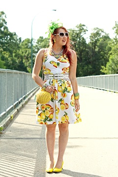 Everyday Outfit for August 13, 2014, Banana Republic cotton lemon citrus print dress, Kate Spade Vita Riva Wicker Lemon clutch purse bag, BCBG Max Azria perforated double white waist belt, BCBG Max Azria silver floral stone chain bold statement necklace, Precis petite neon green feather fascinator, John Fluevog yellow linen Desmond Big Presence pump shoes