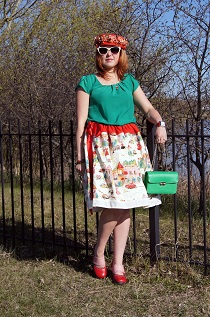 Everyday Outfit for May 6, 2012,  Reitmans bright green blouse, Roobys Paris street scene printed full retro 50's skirt, Vintage 50's white petticoat skirt, Vintage red straw flower hat, Swarovski fish necklace, Joan Rivers watch, The shopping Channel gemstone stretch bracelets, Deanne Watson earrings, Vintage green leather clutch handbag, Fluevog red pink Mini Zaza